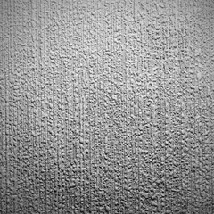 Silver background with rough surfaces.