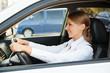 prosperous businesswoman driving the car