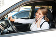 woman sitting in the car and talking on the phone