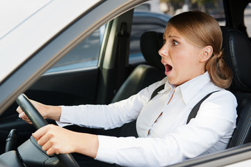 frightened woman holding the steering wheel