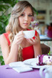 alluring woman with cup of tea