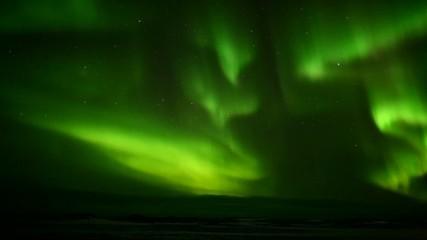 Green Aurora Borealis on the Arctic sky, Svalbard