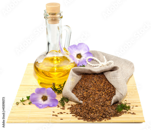 Sack of flax seeds and glass bottle of oil