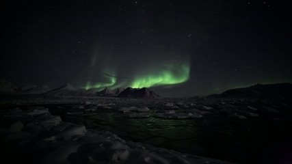 Aurora Borealis over the frozen Arctic fiord