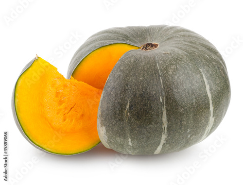 green pumpkin with orange slice