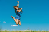 happy young woman jumping high in air