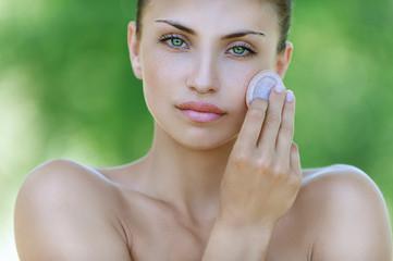 calm young woman handles face creams
