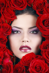 Portrait of young beautiful stylish girl with beautiful roses