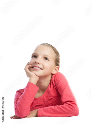 Cute girl thinking over a white background