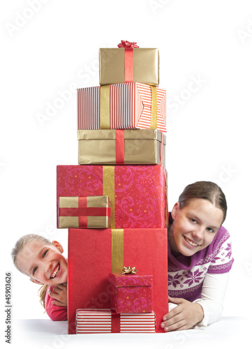 Two cute girls with a bunch of presents