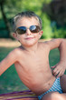 Funny boy outdoors portrait with sunglasses.