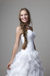 beautiful smiling girl in a white wedding dress