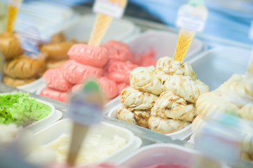 Variety of yummy ice creams under shopping window