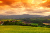 Green meadow under sunset sky with clouds - 45907428
