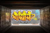 Dark tunnel with grafiti