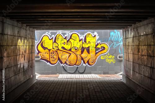 Dark tunnel with grafiti - 45909881