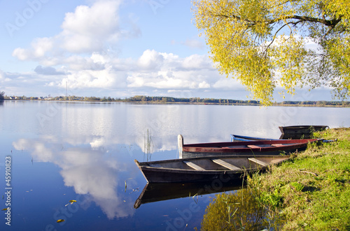 autumn lake lasndscape with boats