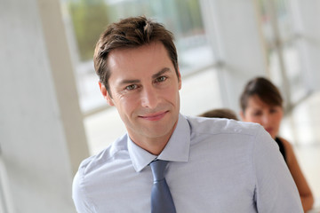 Smiling businessman attending work meeting