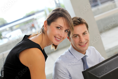 Business people working on desktop computer in office