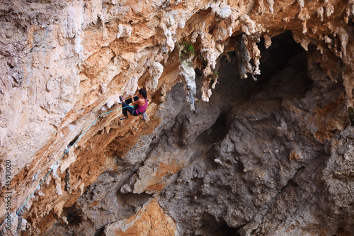Female rock climber on a cliff face