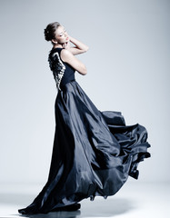 fine art fashion photo of beautiful woman model in elegant dress