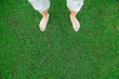 Bare feet of the man standing on fresh green grass
