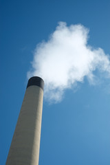 Iindustrial chimney with smoke pollution