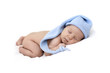 newborn baby curled up sleeping on a blanket