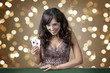 Sexy beautiful young girl in casino on the background bokeh