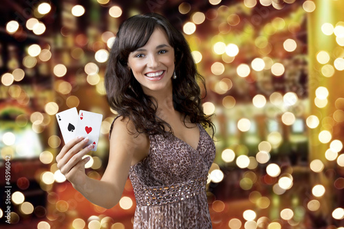 Sexy beautiful young girl in casino (background bokeh)