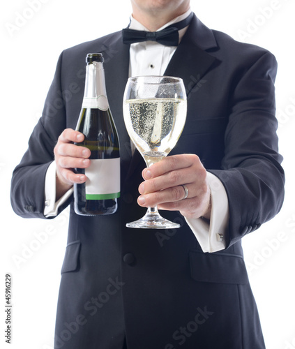tuxedo presenting glass of wine