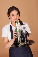 Beautiful waitress serving champagne