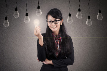 Smart Businesswoman with light bulb