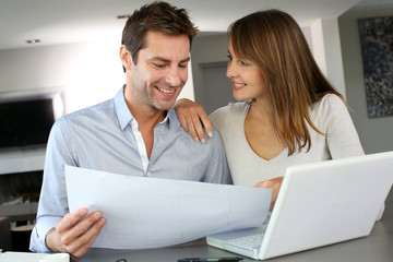 Couple looking at future home blueprint