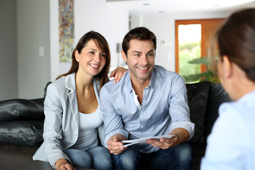 Couple meeting consultant for financial contract