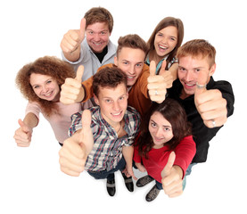 Group of happy joyful friends standing with hands up isolated