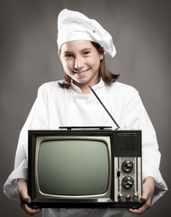 chef  holding television