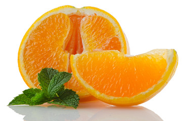 Orange fruit segment and mint leaf