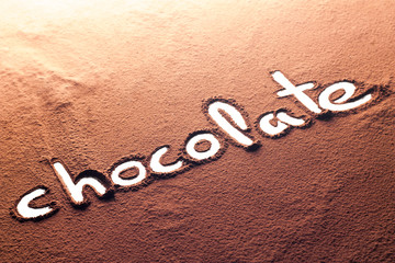 Chocolate written with cocoa powder