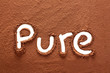 Pure written with cocoa powder