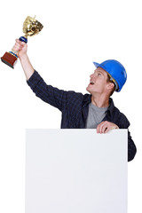 Tradesman holding up a trophy