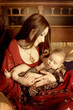 beautiful indian woman laying with baby in ethnic interior