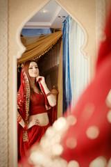 Beautiful Indian bride looking in mirror