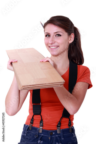 handywoman holding wooden boards