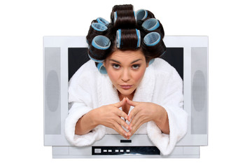 Woman with rollers in hair escaping from television