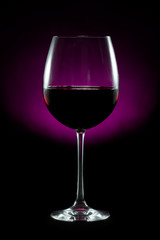 Elegant glass of red wine isolated on black background