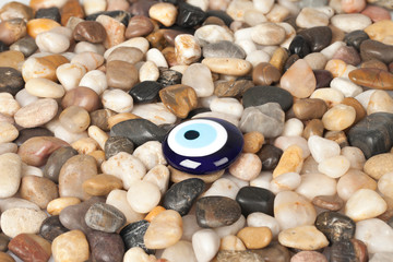Blue Evil Eye Blue on the pebbles background