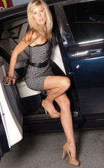 Legs! Beautiful blond woman exiting a luxury car.