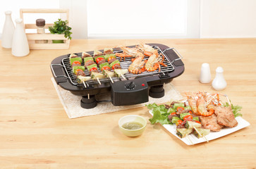 Electric appliance barbecue grill in the kitchen