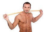 man showing off with stick against white background